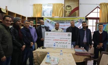 حركة فتح تقدم منحة النائب محمد دحلان لعدد من أندية الوسطى